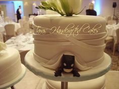 This little Batman is soooo cute!  Front of the cake is elegant and the back of the cake has a little hidden surprise for the groom.