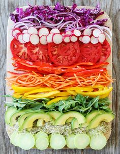 Rainbow Vegetable Sandwich Recipe on twopeasandtheirpod.com This healthy and delicious sandwich is layered with colorful veggies. It is the ultimate veggie sandwich!