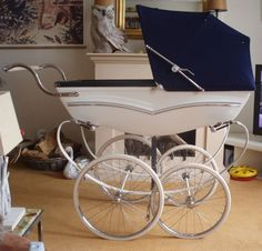 Love this vintage British type baby carriage.... wonder if parents in Charlotte NC may start strolling their newborns in these.