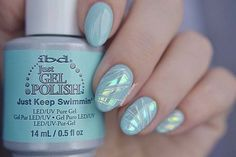 Polish Madness made Just Keep Swimmin' a winter delight by topping the pale blue-green crème with 'ice shards'.    #ibdbeauty #justgelpolish #winternails #bluenails #manicure
