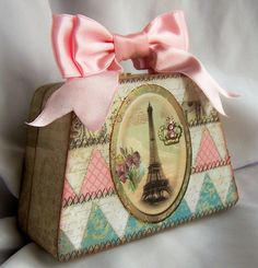 Bow for a handle! This is purely decorative but I think I could create something like this bow handle.... Eiffel Tower Bag
