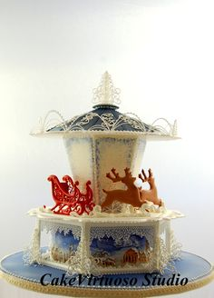 Christmas carousel cake, all royal icing, panels-lace work-stringwork.