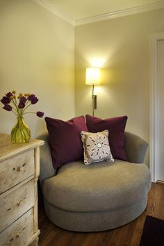Great corner chair ---Choose an oversized chair in a small space -- makes a statement -- gives comfy style