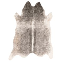 Fall is the ultimate time for layering with a neutral cowhide rug