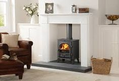 Highly efficient and highly versatile, the Stockton 5 is both a wood burning and multi fuel stove, providing premium finishes including external riddling and a heat shield. Wood Stove Hearth, Wood Burner Stove, Wood Burner Fireplace, White Fireplace, Fireplace Design, Bioethanol Fireplace, Fireplace Ideas, Log Burner Living Room, Living Room With Fireplace