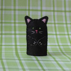 Hey, I found this really awesome Etsy listing at http://www.etsy.com/listing/74782187/black-cat-finger-puppet-with-green-eyes