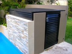Pool equipment enclosures are absolutely required to protect the pool equipment and to make its look better and more aesthetic. Compare it when pool equipment does not covered by the proper enclosures. Pool Equipment Enclosure, Pool Equipment Cover, Glass Pool Fencing, Pool Fence, Swimming Pools Backyard, Pool Landscaping, Pool Pumps And Filters, Hidden Pool, Pool Shed