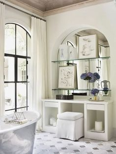Beautiful Bathrooms * Arched, mirrored alcove with shelves, arched window