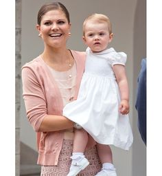 Crown Princess Victoria—and her 1-year-old daughter Princess Estelle, both dressed in classic style—attend a national celebration on the princess's 36th birthday on 14 July 2013, in Borgholm, Sweden