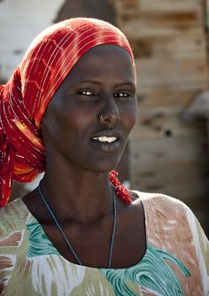 Afar woman:  She lives in the middle of nowhere, around Obock area, near Khor Angar, not far from the Eritrean border, in a village that consists of just two huts in the desert. One of the hottest place to live on earth. Djibouti.  by Eric Lafforgue, via Flickr.