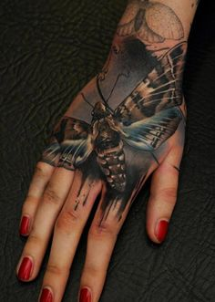 Realistic Hand Moth Tattoo - Florian Karg http://inkchill.com/realistic-hand-moth-tattoo