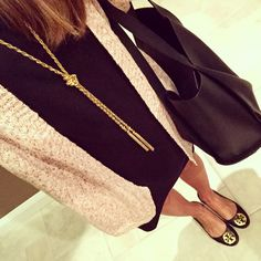 Black swing dress with long cardigan. Tory burch reva flats. Gold tassel necklace. Black tote bag.