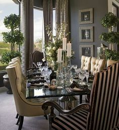 My favorite thing about this set is the chairs. It's so important to dine in comfortable chairs. The dark stripes at the head of the table are a perfect accent to the lighter cream chairs in the center. Spot on.