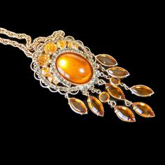 Vintage Hobe Amber Pendant Brooch Rhinestone Crown Crystal drops This vintage pendant / brooch had dangling bezel set glass stones  Approximate