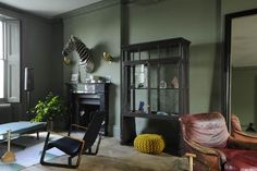colors, mustard poof  A Daring Townhouse in Notting Hill : Remodelista