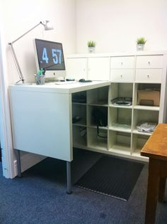 Quick Expedit Standing Desk. I have the raw materials, so perhaps in its next life I'll try a standing desk version.