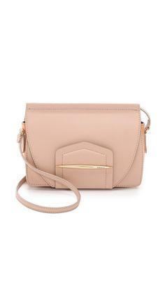 Shop now: Nina Ricci Leather Cross Body Bag