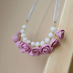 Necklace with hand made fimo roses and white glass beads.