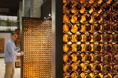 I must go to the blatz brewery in milwaukee to see this.detail: BRILLIANT beer bottle pivot doors at 'blatz brewery' in milwaukee, wisconsin by johnsen schmaling architects Wine Bottle Wall, Wine Wall, Bottle House, Bottle Art, Bottle Crafts, Reuse Bottles, Glass Bottles, Beer Bottles, Bar A Vin