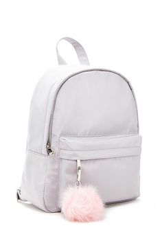 A large structured sheeny backpack featuring a high-polish zip front, front zip pocket with a pom pom clip, a top handle, interior patch pockets, and adjustable buckle straps. Pretty Backpacks, Cute Mini Backpacks, Stylish Backpacks, Girl Backpacks, White Backpack, Backpack Purse, Cute School Bags, Girls Bags, Cute Bags