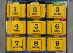 Maori numbers 1-9 at a playground.