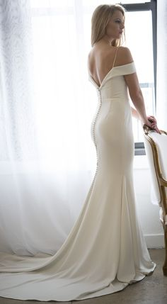 Phoebe wedding dress by Kelly Faetanini | Crepe slim bridal gown with criss-cross off the shoulder sleeve and spaghetti strap shoulder detail | Simple wedding gown #weddingdress #weddingdresses #bridalgown #bridal #bridalgowns #weddinggown #bridetobe #weddings #bride #weddinginspiration #dreamdress #fashionista #weddingideas #bridalcollection #bridaldress #fashion #bellethemagazine #ido #dress