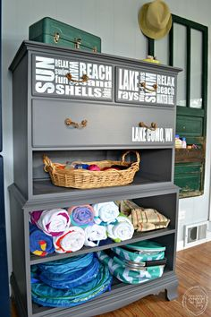 Great idea for repurposing an old dresser that's missing drawers. This would be great at a lake house or beach house to hold towels and beach supplies.  Perfect for a mudroom too.