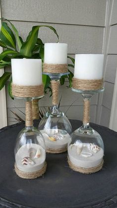 This is a set of 3 Wine glasses turned into Candle holders. Inside Wine glasses are colored sand and real seashells. The color blue in pictures I am having trouble getting but I have other color options. See pictures. I have light blue, dark blue, medium blue, coral, natural color,