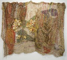 made from metal tops to liquor bottles   Artist : El Anatsui
