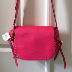 SALE❗️NWT! stunning  Coach handbag Amazing bag from coach boutique... Pink Ruby and neon orange with gold hardware.  Adjustable strap can be shoulder bag or crossbody. Coach Bags Crossbody Bags