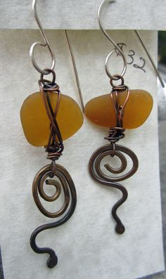 Amber Sea Glass and Brass Swirl Earrings. $32.00, via Etsy.  Stacilouise