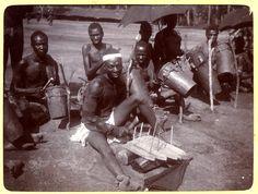 Photograph (black and white) from an album; Group of drummers. Ikot Ekpene, Nigeria, 22 November 1905.   Gelatin silver print