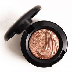 """MAC Sweet Heat Extra Dimension Eyeshadow ($20.00 for 0.04 oz.) is described as a """"bright peach champagne."""" It's a light-medium, peachy beige with warm undertones and a metallic sheen. It had semi-opaque color payoff that stayed on well for six and a half hours when applied dry, while damp application yielded full coverage that wore …"""