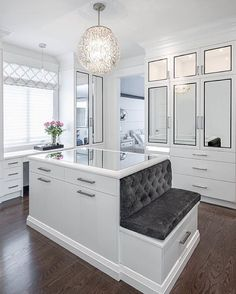 Center island in center of closet genius to hide laundry and hold jewelry in top drawer - can have top drawer lock with key. Plus vanity next to open window facing south east for good morning light