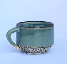 This matte blue latte mug my favorite mug shape, a little shorter and wider than your average mug. Its cozy to hold and the matte glaze is silky smooth to touch. It will hold 16 oz (or 2 cups) of liquid. The hand carved design on the bottom gives it an extra touch of handmade-ness. Not