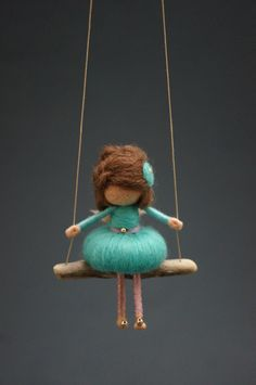 YOU ARE BUYING A DORIMU FAIRY DOLL ON A DRIFTWOOD SWING LIKE THE ONE SHOWN IN THE PICTURES. THE FAIRY WILL BE MADE FOR YOU FROM SCRATCH AND WILL BE FINISHED WITHIN THREE WEEKS. MINOR VARIATIONS ARE POSSIBLE (LENGTH OF THE HAIR, COLOR AND SHAPE OF THE SWING). IF YOU WOULD LIKE HER TO HAVE A DIFFERENT HAIR STYLE, A DIFFERENT HAIR COLOR OR A DRESS IN A DIFFERENT COLOR PLEASE LET US KNOW - CHECK THE COLLAGE ON THE LAST PICTURE FOR THE COLORS AVAILABLE. Dorimu Fairies are miniature figurines…