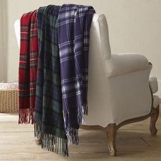 strewn plaid blankets across the back of a chair
