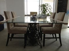 DIY Dining Table made from recycled glass and Singer sewing table legs.