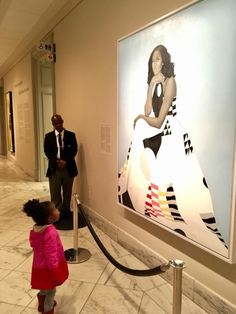 "Parker Curry, age 2, seeing the portrait of Michele Obama.""Her joy and her awe were infectious,""  said photographer Ben Hines. His mom added: ""She had such wonder on her face and her entire body just stopped as she looked at her, and she had this wonder that was silent and yet seemed to be saying something very big at the same time..."" Story at link."