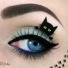 Be inspired by this look! A tiny black kitty takes a peek from a faded turquoise lid in this perfectly detailed, flawlessly executed eye makeup art.