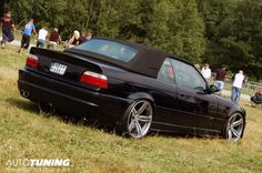 Even stock wheels on a BMW look great on a black convertible, this shot was taken out in the country where the grass grows tall. Bmw E30 Cabrio, Bmw M3 Convertible, Bmw Black, New Bmw, Bmw Cars, Sexy Cars, Dream Cars, Indiana Jones, Sport Cars