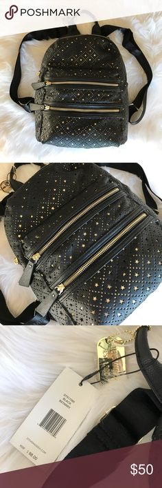 Steve Madden Backpack New Steve Madden Backpack in black & gold with a star cut out pattern. Two front zip pockets & one large interior zip compartment with additional pockets inside. This could be for school, travel or even a baby bag! Steve Madden Bags Backpacks