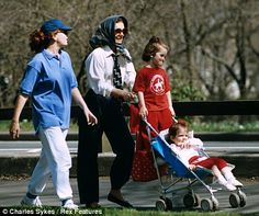 Jackie with Caroline, left, and granddaughters Rose and Tatiana  in Central Park, New York, in 1992.