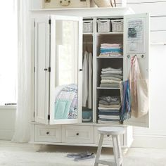 giant wardrobe with shelves, small draws and a mirror door - perfect for apartments with no closet