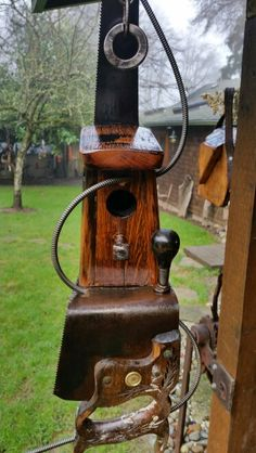 Birdhouse made from old saw and recycled materials.