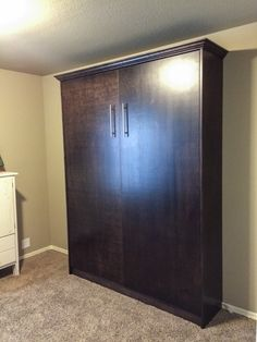 Custom, dark stained Fremont Collection murphy bed by Murphy Wallbed USA. murphywallbedusa.com  #murphy #bed #wallbed #murphywallbedusa #custom #cabinet