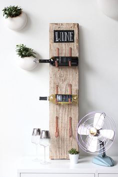 DIY your own wine rack with this cool tutorial made from an old board!