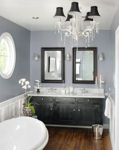 love the gray and white with the dark wood and black vanity accents...hardwood floors in the bathroom?? Love the look, but is it practical??!! Decisions, decisions...