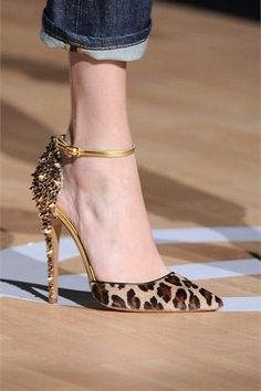 Stunning leopard print heels - with a delicate ankle strap and studded heels/back.