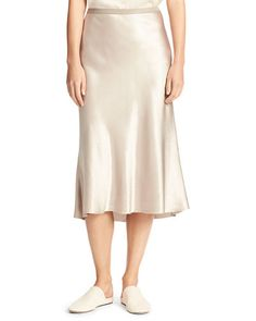 "Vince slip-style skirt in Japanese satin. Approx. 33""L. Grosgrain elastic waistband. Bias-cut silhouette. Hem falls past knees. Pull-on style. Acetate. Hand wash or dry clean. Imported."